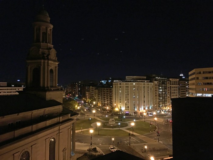 Nighttime view of Thomas Circle all lit up in Washington, D.C.