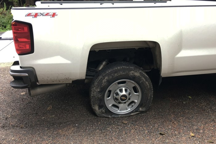 Our truck with a flat tire on the side of the road