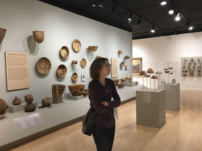 Christina admiring basketry at the Palm Springs Art Museum