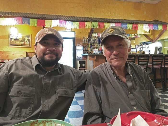 Michael and his father sitting at a table at Carlito's Mexican restaurant in Red Bluff, CA