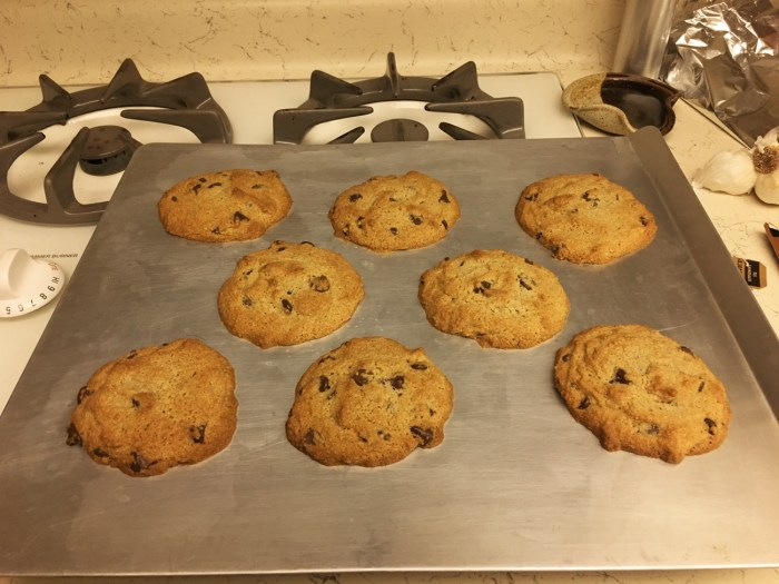 A baking sheet with chocolate chip cookies made with almond flour