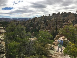 Christina standing on a rock ledge looking out over the sea of pinnacles at Heart of Rocks