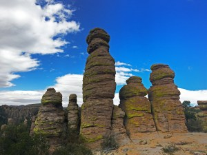 A row of six pinnacles that appear to be a group of siblings or friends of various sizes