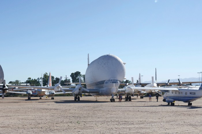 Large, awkward cargo plane called the Super Guppy parked outside