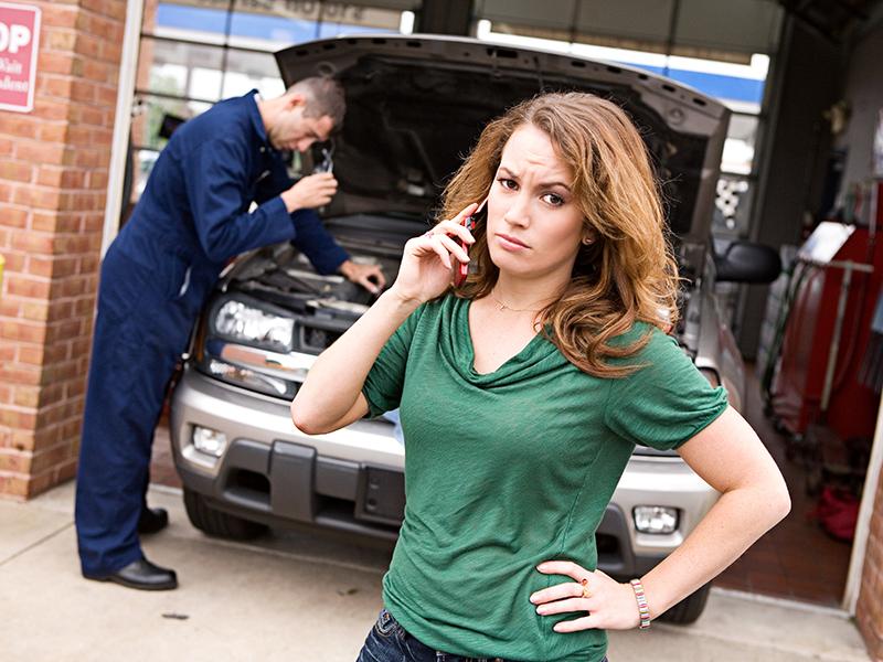 Woman at Mechanic