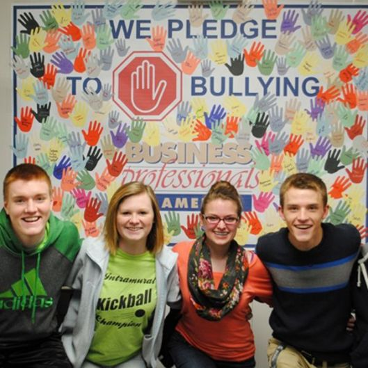 4 students posing