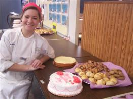 student posing with baked goods
