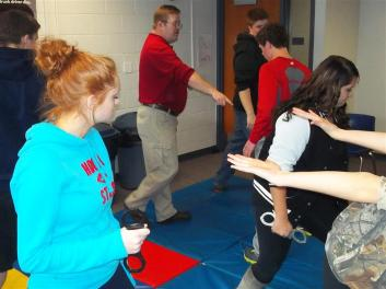 student practicing handcuff teqniques