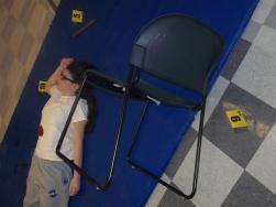 student in a pretend crime scene