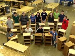 students posing with cabinet projects