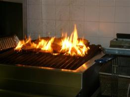 cooking with fire on grill