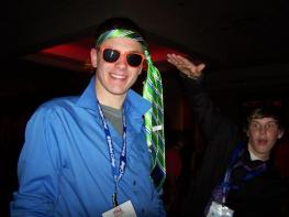 student wearing sunglasses at night with necktie around his head