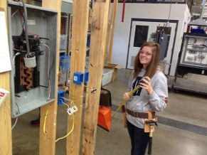 student posing with her project