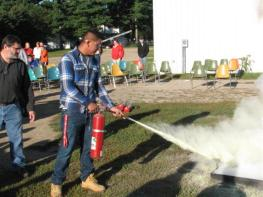 student using a fire extinguisher