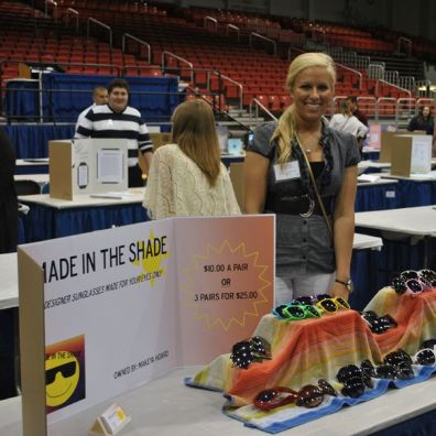 student selling sunglasses