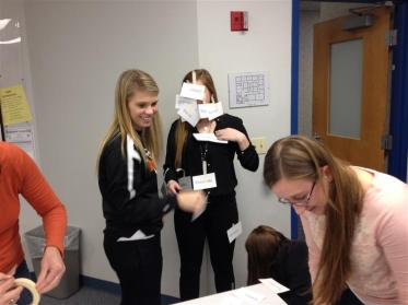 Students with anatomy names taped to them