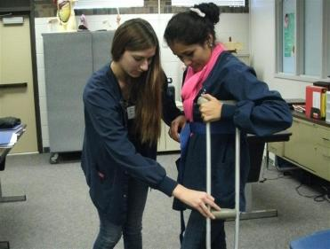 2 students practicing with crutches