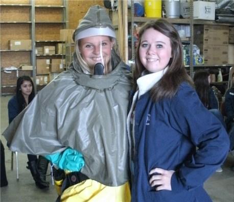 2 students posing in Haz Mat suit