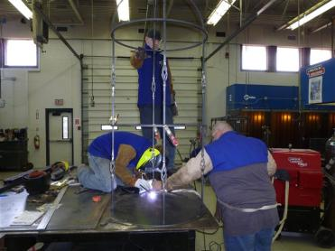 student welding a steel structure