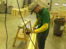 Student Measuring a Board