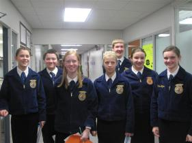 students in blue blazers preparing to compete