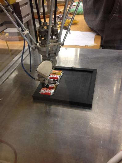 spider robot arm over small candy bars