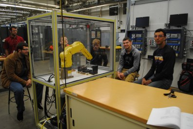 students observing a robot