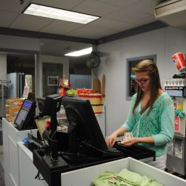 student working the cash register