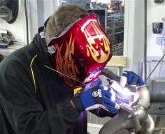 student performing a TIG weld