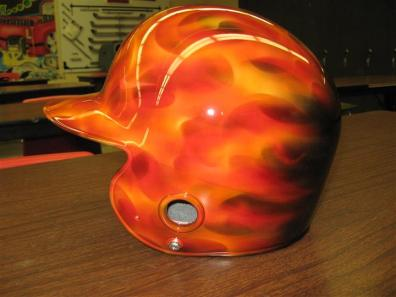 orange flames on baseball helmet