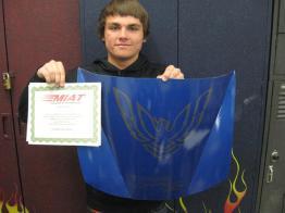 student holding blue hood