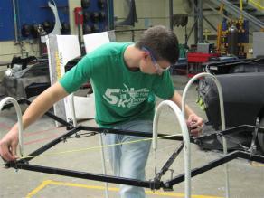 student taking frame measurements