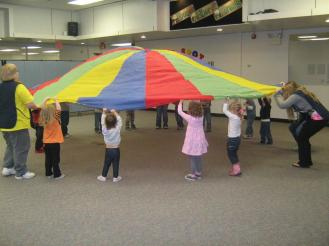 Students raising a colerful parachute