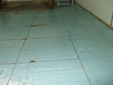 can i put a new floor over asbestos tiles