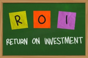 Business concept of Return on Investment written on sticky colored paper