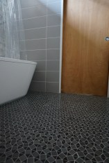 Floor tile and sliding pocket door