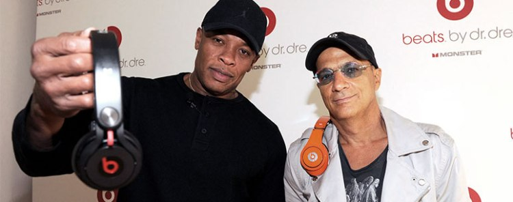 Beats founders Dr. Dre and Jimmy Iovine holding their product
