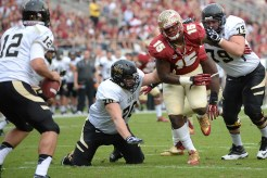Mario Edwards chases the Idaho quarterback