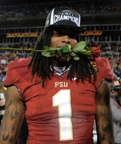 Kelvin Benjamin clenches a rose