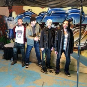 novak with friends and graffiti background