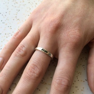 love_ring_hand_stamped_sterling_silver_female_hand_model1