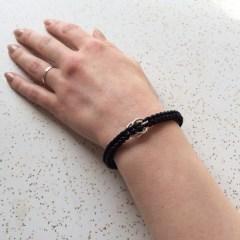 woven_stretch_bracelet_black_rubber_sterling_silver_double_ring_closure_female_hand_model