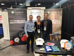 Steve Hearon, Carly Pendley and Nathan Kirkland in front of BrandPoint Services Booth.