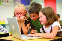 3 children on a computer