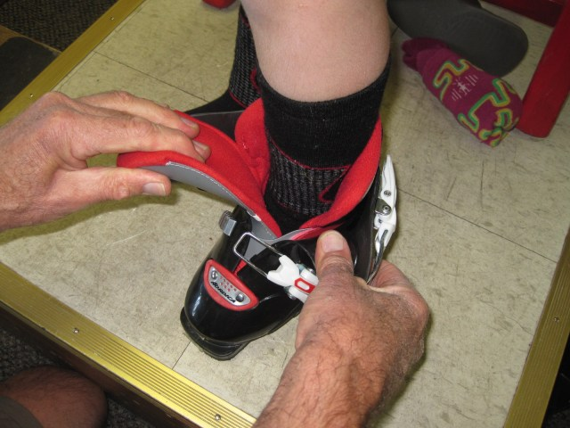 Separating the front of the boot and pullling the tongue way out of the way, makes putting on ski boots much easier.