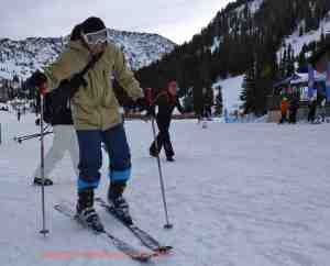 matt gibson clicking into skis  at alta utah