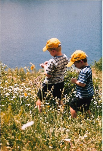 flowers and boys at lake
