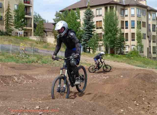 practicing downhill biking skills on a dirt pump track at Bike Snowmass near Aspen Colorado.