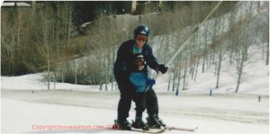 dad and son on the bunny slope