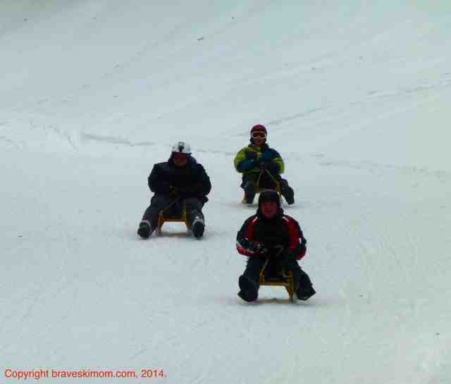 lugers on piste at le massif